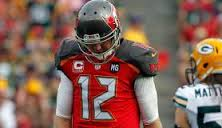 Former Bucs QB Josh McCown hangs his head after a loss to the Packers