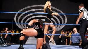 Stacy Keibler distracting the referee during a match on Smackdown.