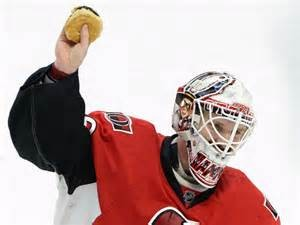 Senator's Goalie Andrew Hammond with a hamburger.