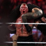 Lesnar delivers his patented finisher to Reigns