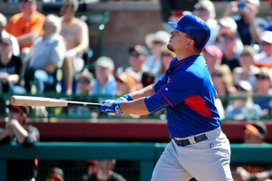 Mar 5, 2015; Scottsdale, AZ, USA; Chicago Cubs catcher Kyle Schwarber (74) hits a gland slam home run during the second inning against the San Francisco Giants during a spring training baseball game at Scottsdale Stadium. Mandatory Credit: Matt Kartozian-USA TODAY Sports