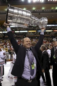 BOSTON, MA - JUNE 24:  Stan Bowman of the Chicago Blackhawks hoists the Stanley Cup after defeating the Boston Bruins in Game Six of the 2013 NHL Stanley Cup Final at TD Garden on June 24, 2013 in Boston, Massachusetts. The Chicago Blackhawks defeated the Boston Bruins 3-2.  (Photo by Bruce Bennett/Getty Images)