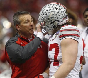 Ohio State defensive lineman Joey Bosa (97)speaks to head coach Urban Meyer in the first half of the Sugar Bowl NCAA college football playoff semifinal game against Alabama, Thursday, Jan. 1, 2015, in New Orleans. (AP Photo/Bill Haber)