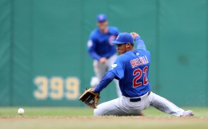 Apr 23, 2015; Pittsburgh, PA, USA; Chicago Cubs second baseman Addison Russell (22) makes a sliding attempt on a ground ball against the Pittsburgh Pirates during the sixth inning at PNC Park. The Pirates won 5-4. Mandatory Credit: Charles LeClaire-USA TODAY Sports