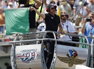 Actor Patrick Dempsey waves the green flag to start the 99th running of the Indianapolis 500 auto race at Indianapolis Motor Speedway in Indianapolis, Sunday, May 24, 2015.  (AP Photo/Sam Riche)