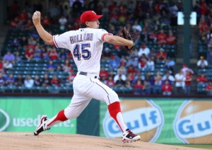 ARLINGTON, TX - SEPTEMBER 30: Derek Holland #45 of the Texas Rangers pitches in game two of the double header against the Los Angeles Angels of Anaheim at Rangers Ballpark in Arlington on September 30, 2012 in Arlington, Texas.  (Photo by Rick Yeatts/Getty Images)