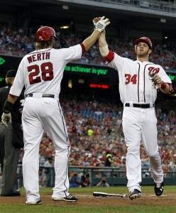 Washington Nationals' Jayson Werth celebrates with Bryce Harper after they scored on Adam LaRoche's two-RBI single during the first inning of a baseball game at Nationals Park Friday, Aug. 31, 2012, in Washington. (AP Photo/Alex Brandon)
