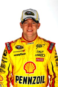 DAYTONA BEACH, FL - FEBRUARY 16:  A.J. Allmendinger, driver of the #22 Shell/Pennzoil Dodge, poses during NASCAR Media Day at Daytona International Speedway on February 16, 2012 in Daytona Beach, Florida.  (Photo by Chris Graythen/Getty Images for NASCAR)