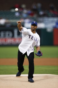 Seattle Seahawks quarterback Russell Wilson throws out the ceremonial first pitch prior to the baseball game between the Texas Rangers and the Philadelphia Phillies, Wednesday, Apr. 2, 2014, in Arlington, Texas. (AP Photo/Jim Cowsert)