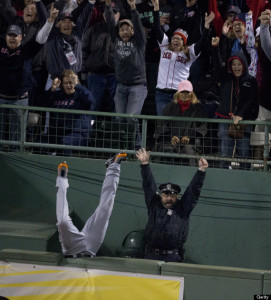 BOSTON - OCTOBER 14: Detroit's Torii Hunter falls into the bullpen trying to catch Red Sox designated hitter David Ortiz's home run that tied the game in the eighth inning. The Boston Red Sox hosted the Detroit Tigers in Game Two of the American League Championship Series at Fenway Park. (Photo by Stan Grossfeld/The Boston Globe via Getty Images)