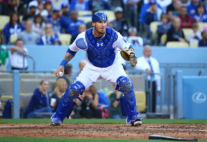 LOS ANGELES, CA - MAY 13: Yasmani Grandal #9 of the Los Angeles Dodgers makes a throw to first base in the fifth inning during the MLB game against the Miami Marlins at Dodger Stadium on May 13, 2015 in Los Angeles, California. The Marlins defeated the Dodgers 5-4. (Photo by Victor Decolongon/Getty Images)